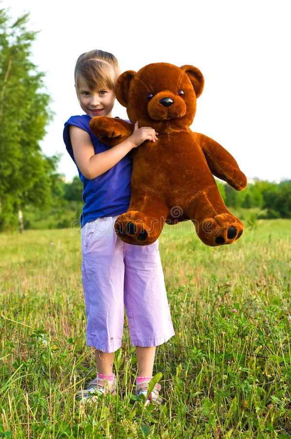 Download Girl With Teddy Bear In A Meadow Stock Image - Image: 20158447