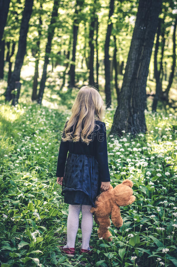 Girl with teddy-bear rear view stock photography