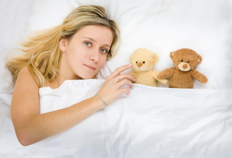 Girl and teddy bears stock image