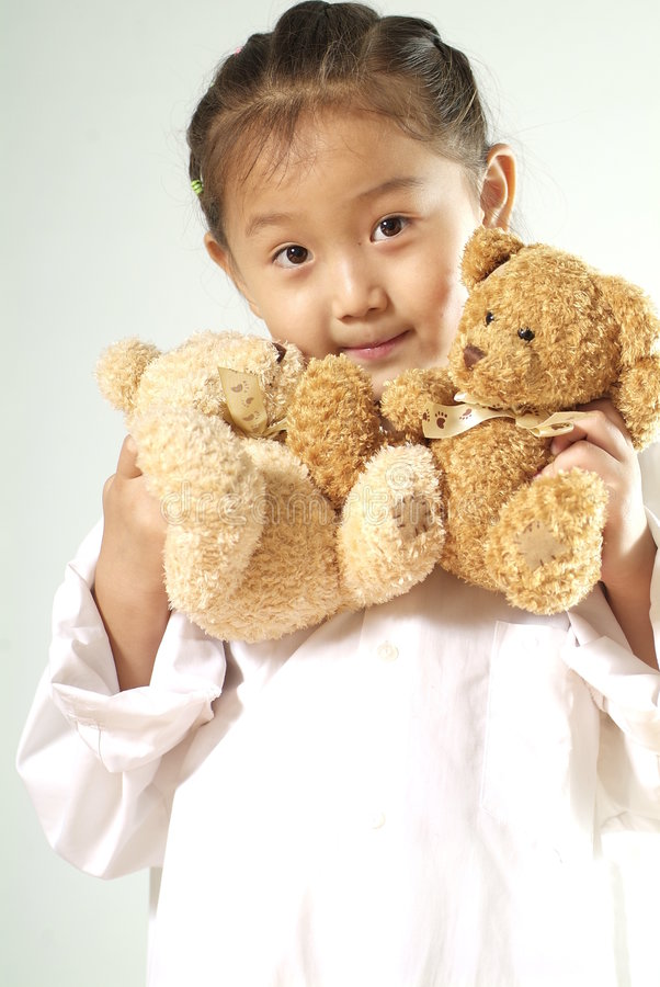 Girl with teddy bears