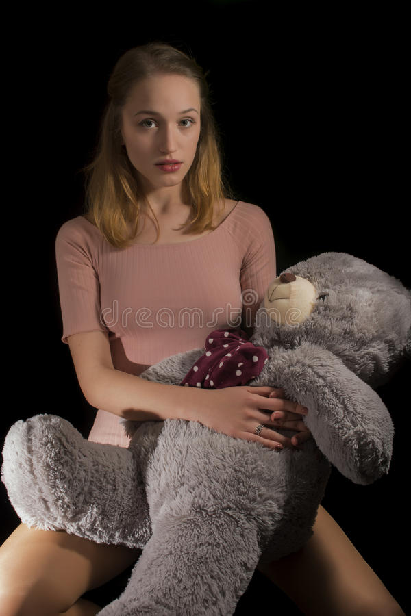 Girl and teddy royalty free stock image