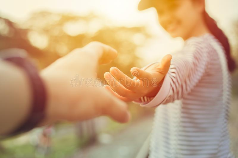 Girl teen smiling and reach her hand. Help Touch Care Support be a Good Friend with Love concept. Outdoor sun shine scene royalty free stock image