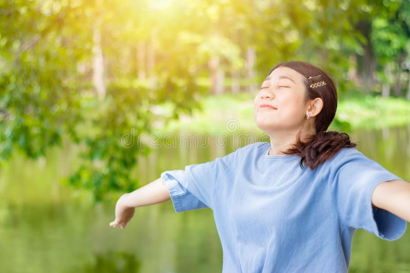 Girl teen young open arms fully breathe fresh clean ozone air in green outdoor park stock photography