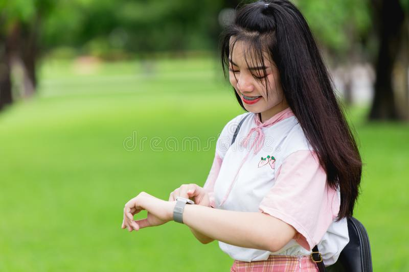 Girl teen young using smart watch to keep tracking her activity outdoor stock photo