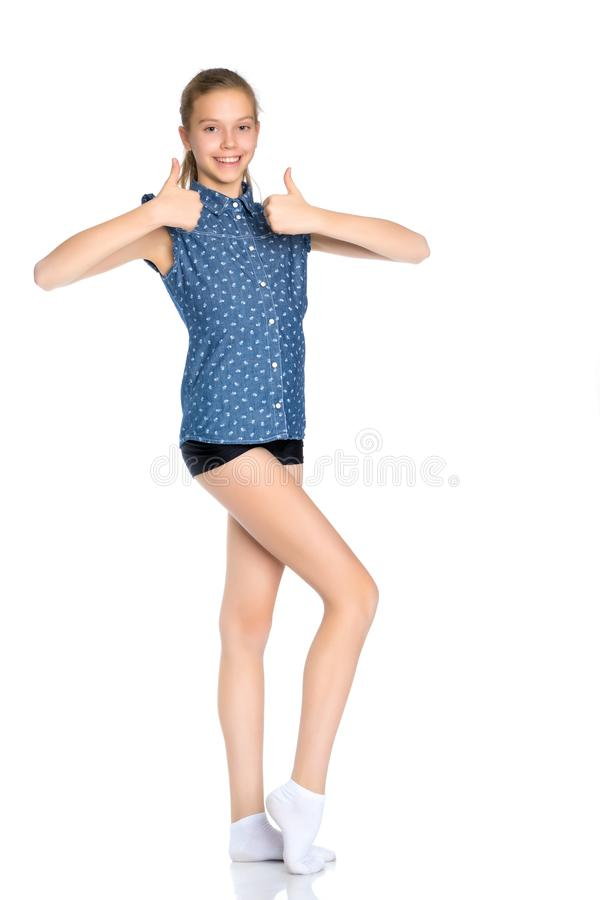 Girl teenager holds a thumb up stock photos