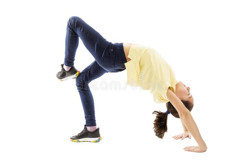 Girl teenager performs acrobatic exercises. Isolated on a white background royalty free stock images