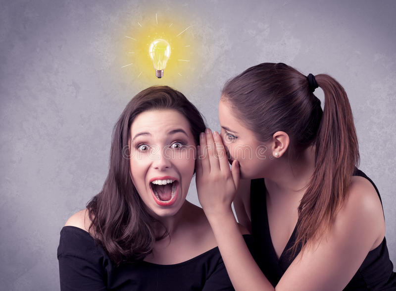Girl telling secret things to her girlfriend royalty free stock photography