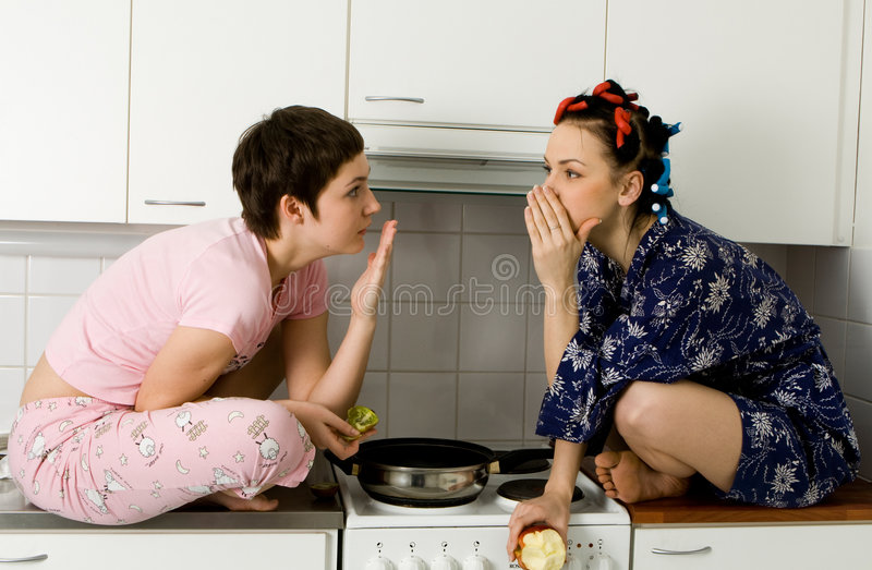 Girl Telling A Secret To Another - Gossip royalty free stock photo