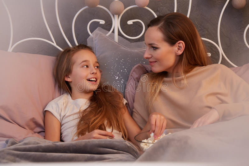Girl telling secrets to mother royalty free stock image