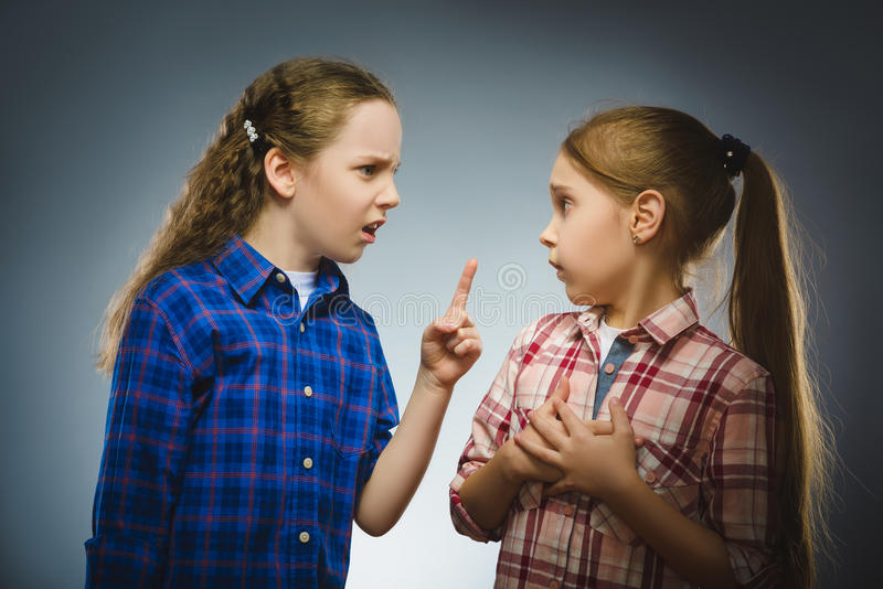 The girl tells the bad news to another girl. Communication concept stock image