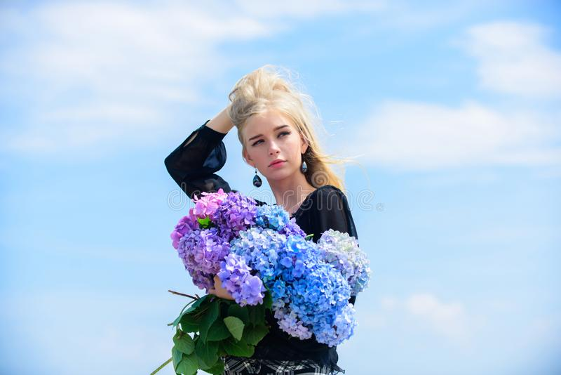 Girl tender blonde hold hydrangea bouquet. Skin care and beauty treatment. Gentle flowers for delicate woman. Pure. Beauty. Tenderness of young skin. Springtime royalty free stock photos
