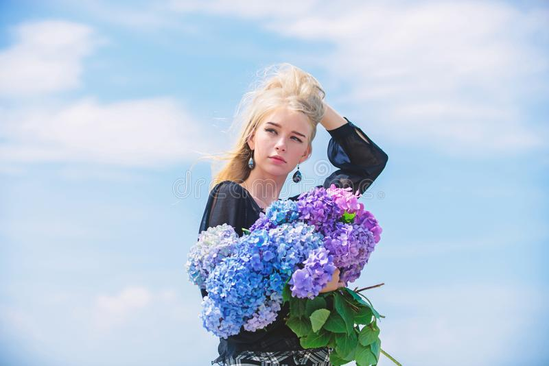 Girl tender blonde hold hydrangea bouquet. Skin care and beauty treatment. Gentle flowers for delicate woman. Pure. Beauty. Tenderness of young skin. Springtime royalty free stock image