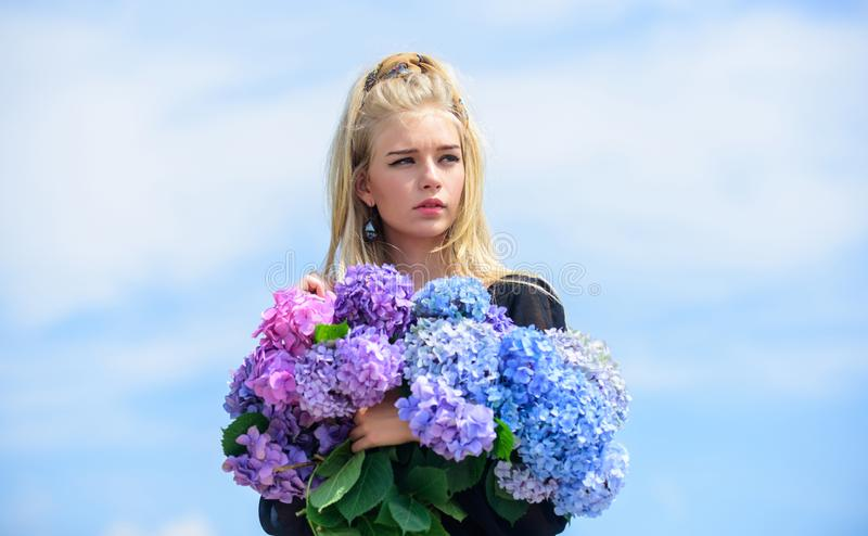 Girl tender blonde hold hydrangea bouquet. Skin care and beauty treatment. Springtime bloom. Gentle flowers for delicate. Woman. Pure beauty. Tenderness of royalty free stock photography