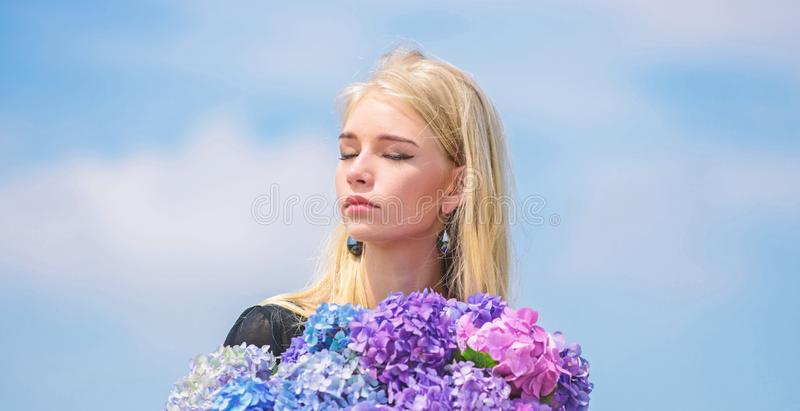 Girl tender blonde hold hydrangea flowers bouquet. Allergy free life. Stop allergy blooming season. Enjoy spring without. Allergy. Springtime bloom. Pollen stock photos