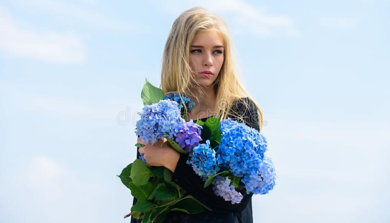 Girl tender blonde hold hydrangea flowers bouquet. Natural beauty concept. Skin care and beauty treatment. Gentle flower. For delicate woman. Pure beauty royalty free stock photography