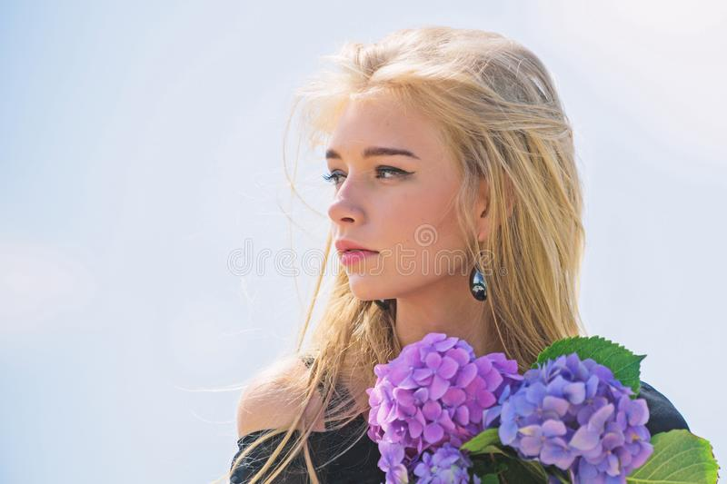 Girl tender fashion model hold hydrangea flowers bouquet. Fashion and beauty industry. Meet spring with fresh bouquet. Flowers tender fragrance. Celebrate stock image