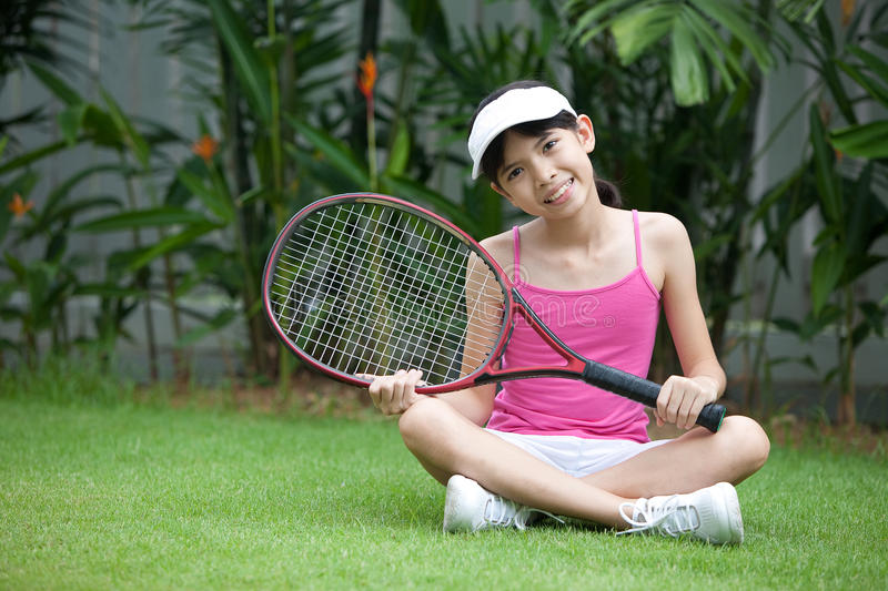 Download Girl with a tennis racket stock image. Image of gear - 18236667