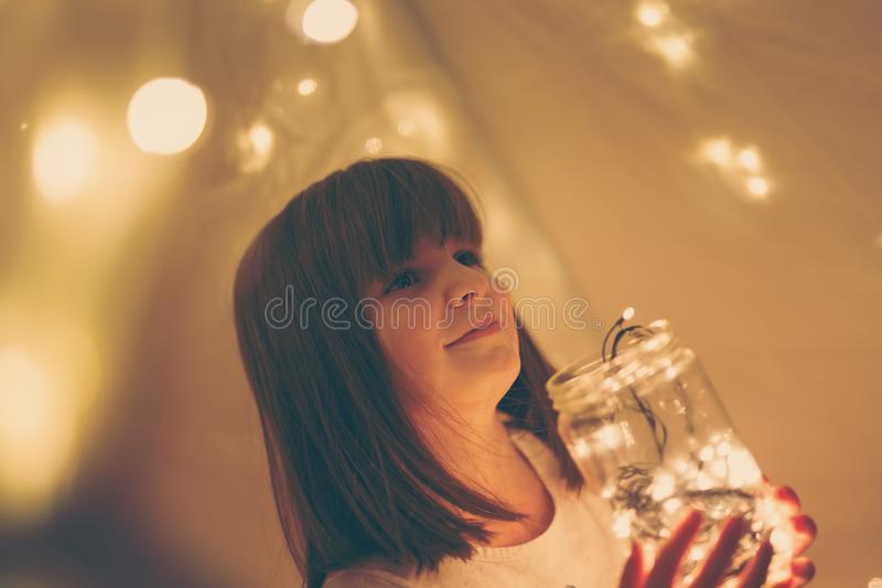Girl in a tent royalty free stock images