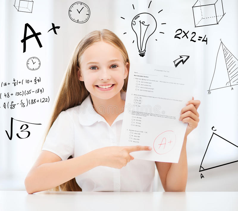 Girl with test and A grade at school stock photos
