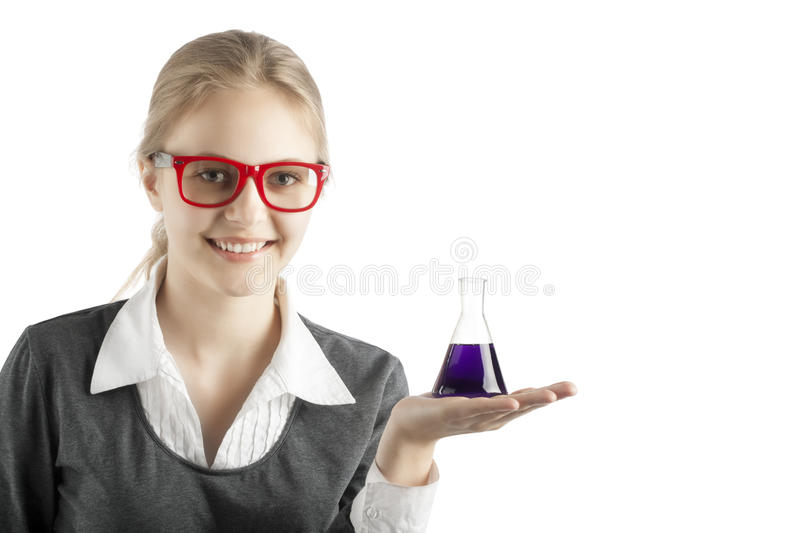 Girl with test tubes and microscope for chemical class royalty free stock photos