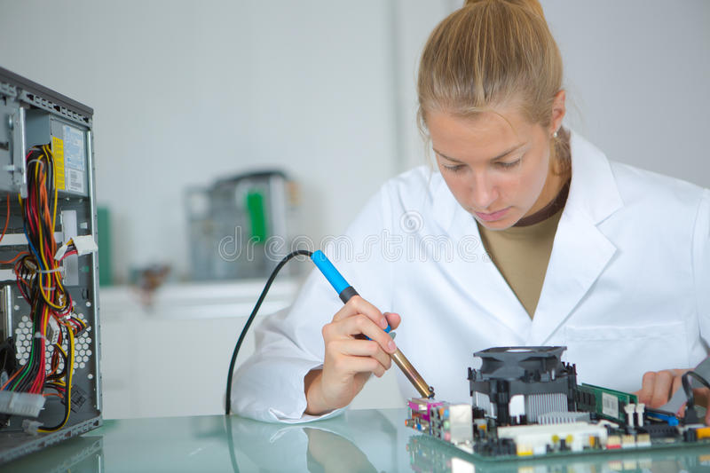 Girl with tester and printed circuit board royalty free stock photo