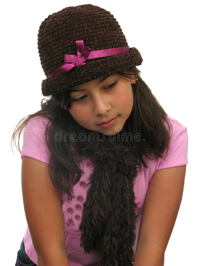 Girl thinking. Portrait of a young girl sitting and thinking royalty free stock photography