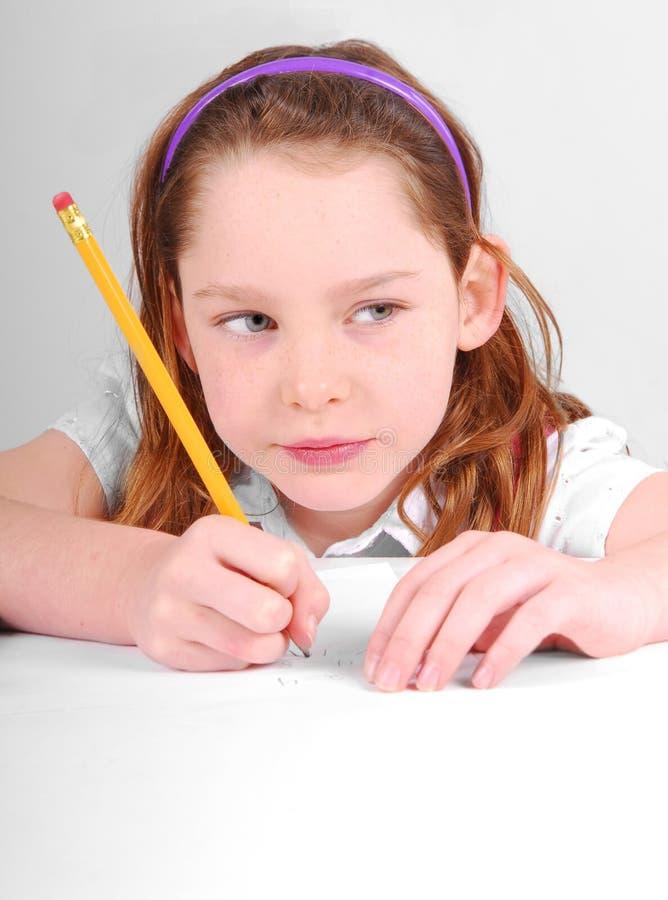 Girl Thinking Hard Doing School Work Royalty Free Stock Photos