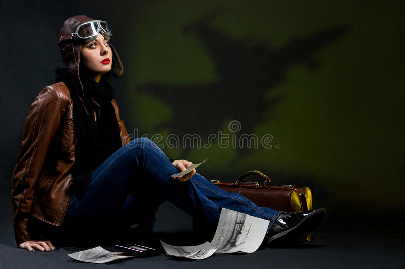 Girl thinks about airplanes stock photography