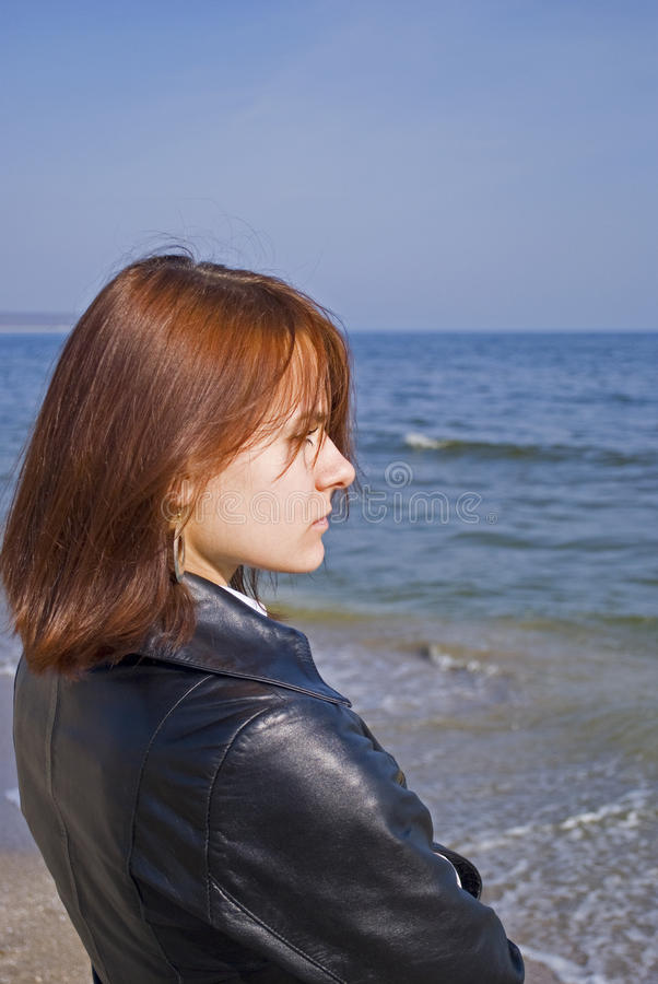 Girl thoughtfully looking into the sea