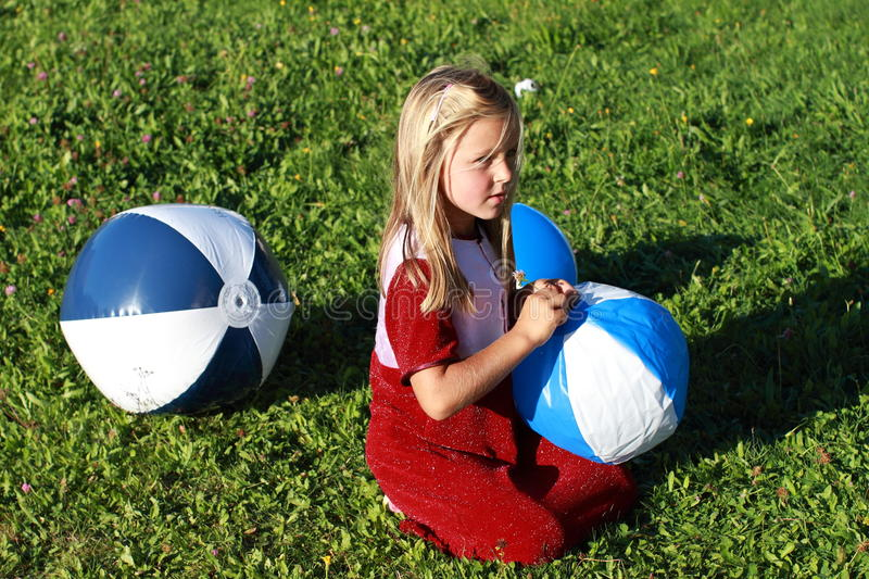 Download Girl with three balls stock photo. Image of blond, green - 21104878