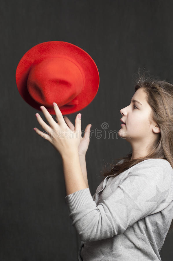 Girl is throwig a red hat royalty free stock images