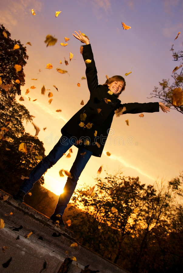 Download Girl Throwing Autumn Leaves Stock Image - Image: 3270127