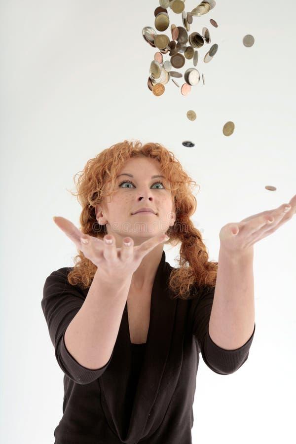 Girl throwing coins into air stock photos