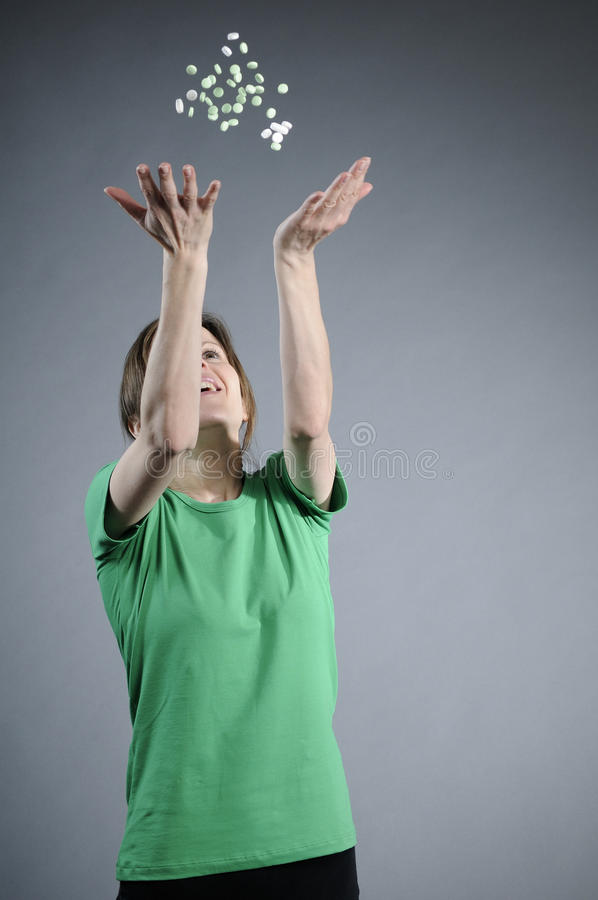 Girl throwing drugs royalty free stock images
