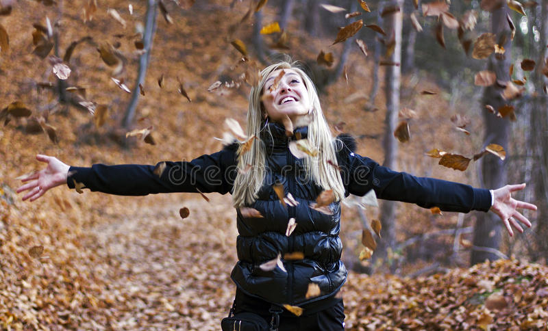 Download Girl Throwing Leaves In Air Stock Image - Image: 16899425