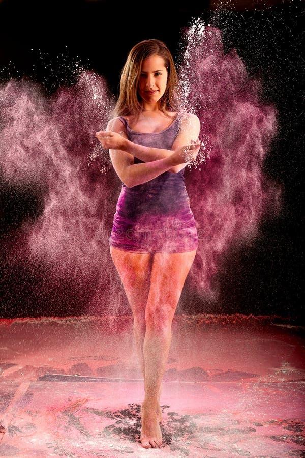 Girl throwing pink powder stock images