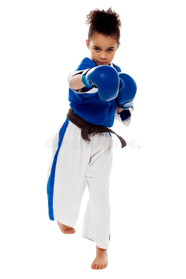 Girl throwing right arm straight punch stock image