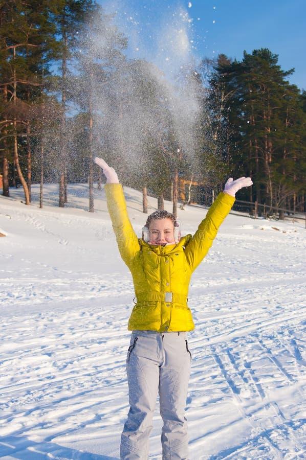 Girl throwing snow royalty free stock image