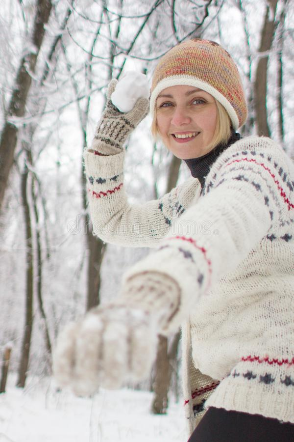 Girl playing snowballs in winter stock photo