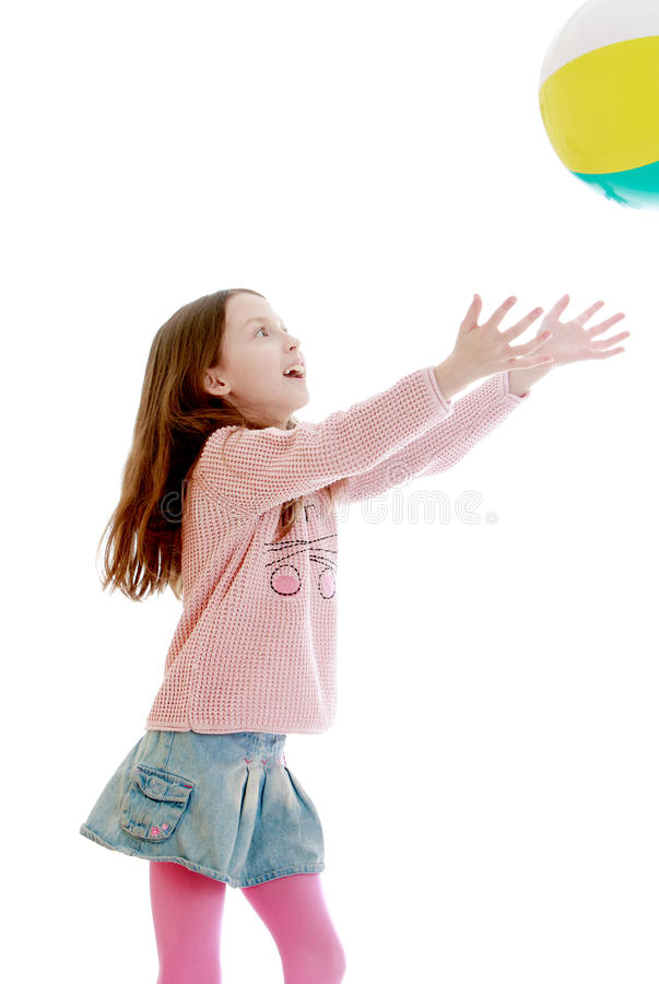 The girl throws the ball royalty free stock photography