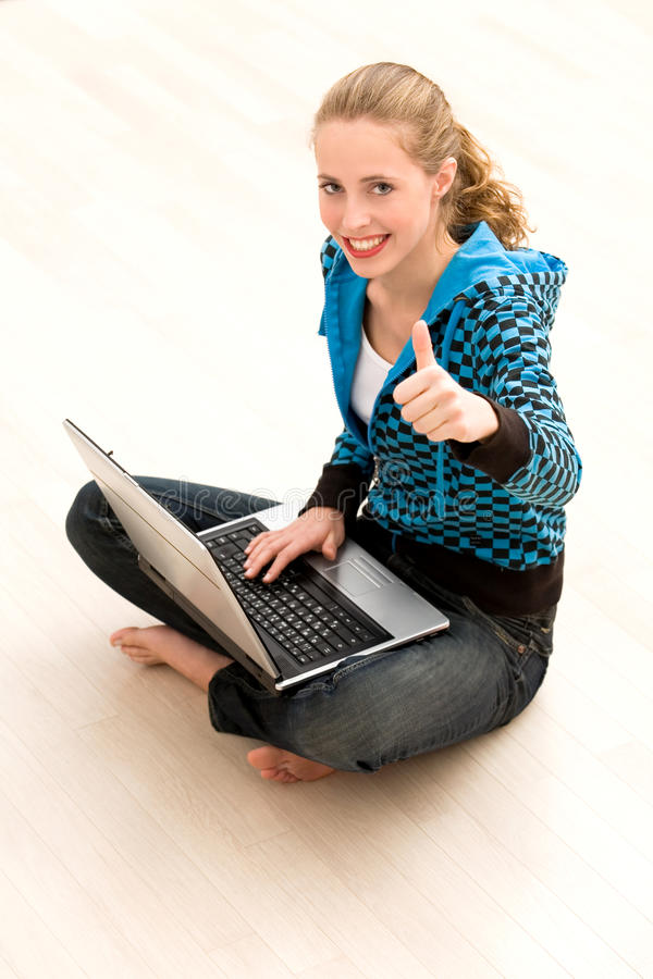 Download Girl With Thumbs Up Using Laptop Stock Image - Image: 11921629