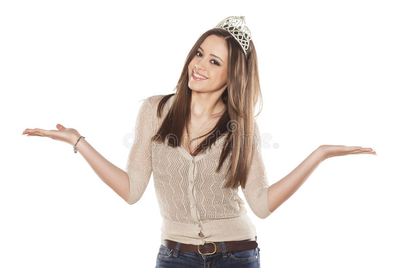 Girl with tiara. Pretty miss with tiara and jeans on white background stock photo