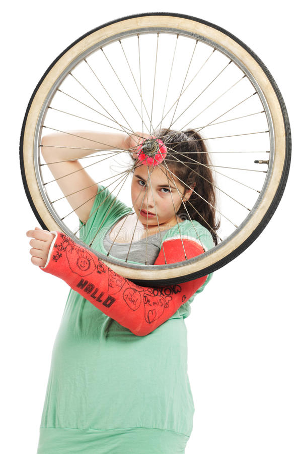 Girl with tire and plaster cast stock photography