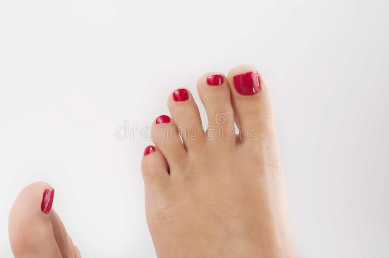 Girl Toes with red nail royalty free stock photo