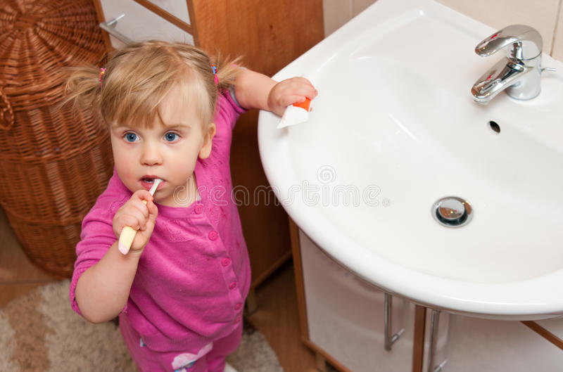 Girl with toothbrush royalty free stock image