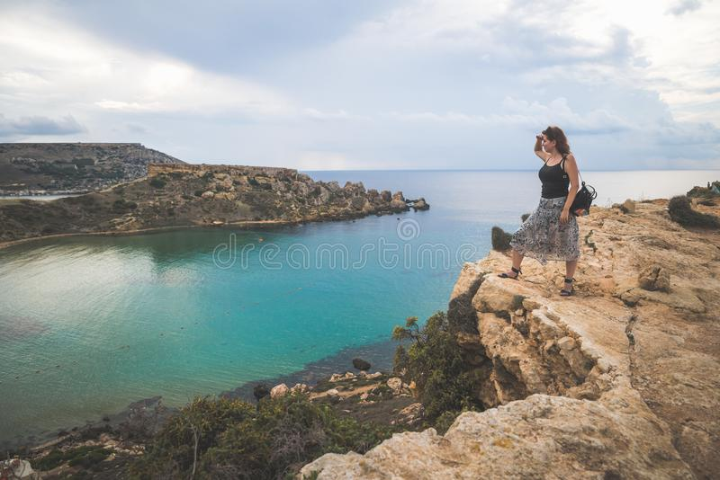 Girl on top of a cliff royalty free stock images