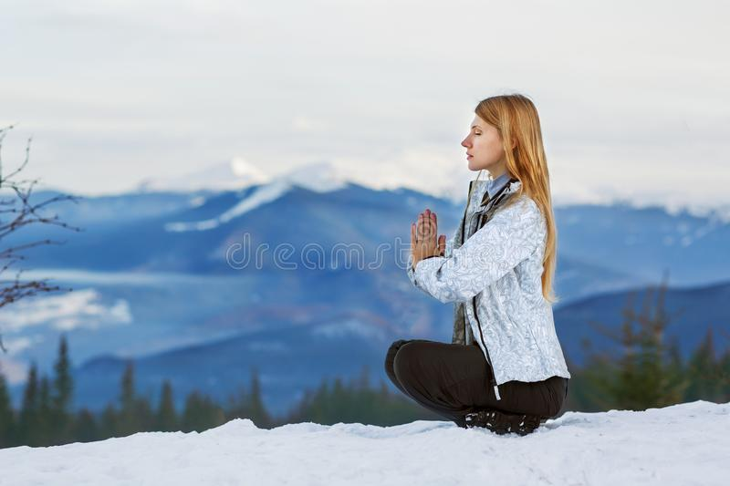 Girl on top of a mountain doing yoga stock photos