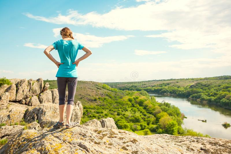 Girl on top of the mountain royalty free stock images