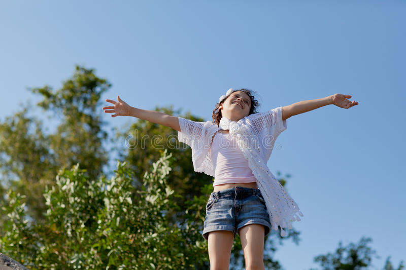 Girl on top of the world stock photo