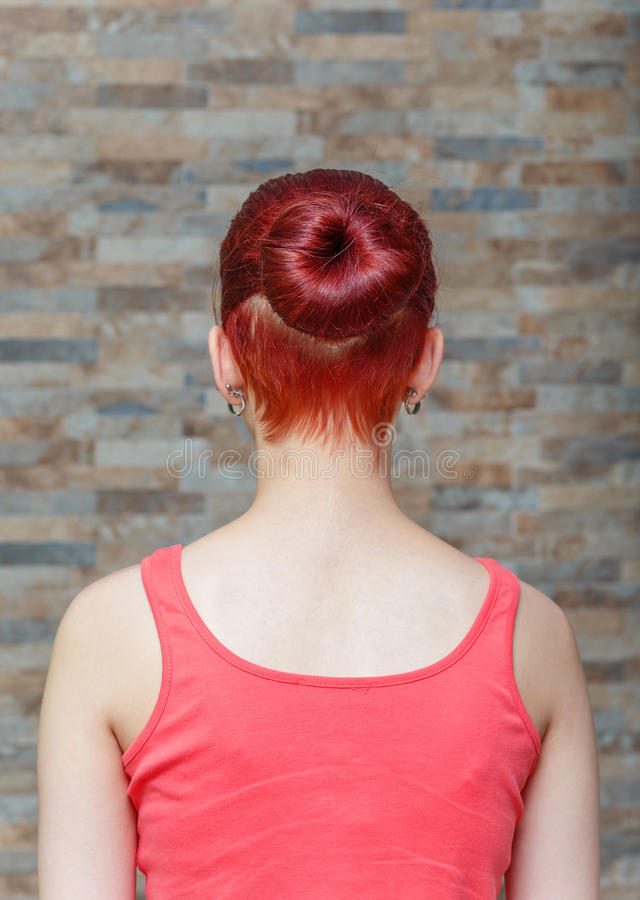 Girl with topknot and hidden undercut. Young model with topknot and hidden undercut on hair. focus on the hair topknot royalty free stock images